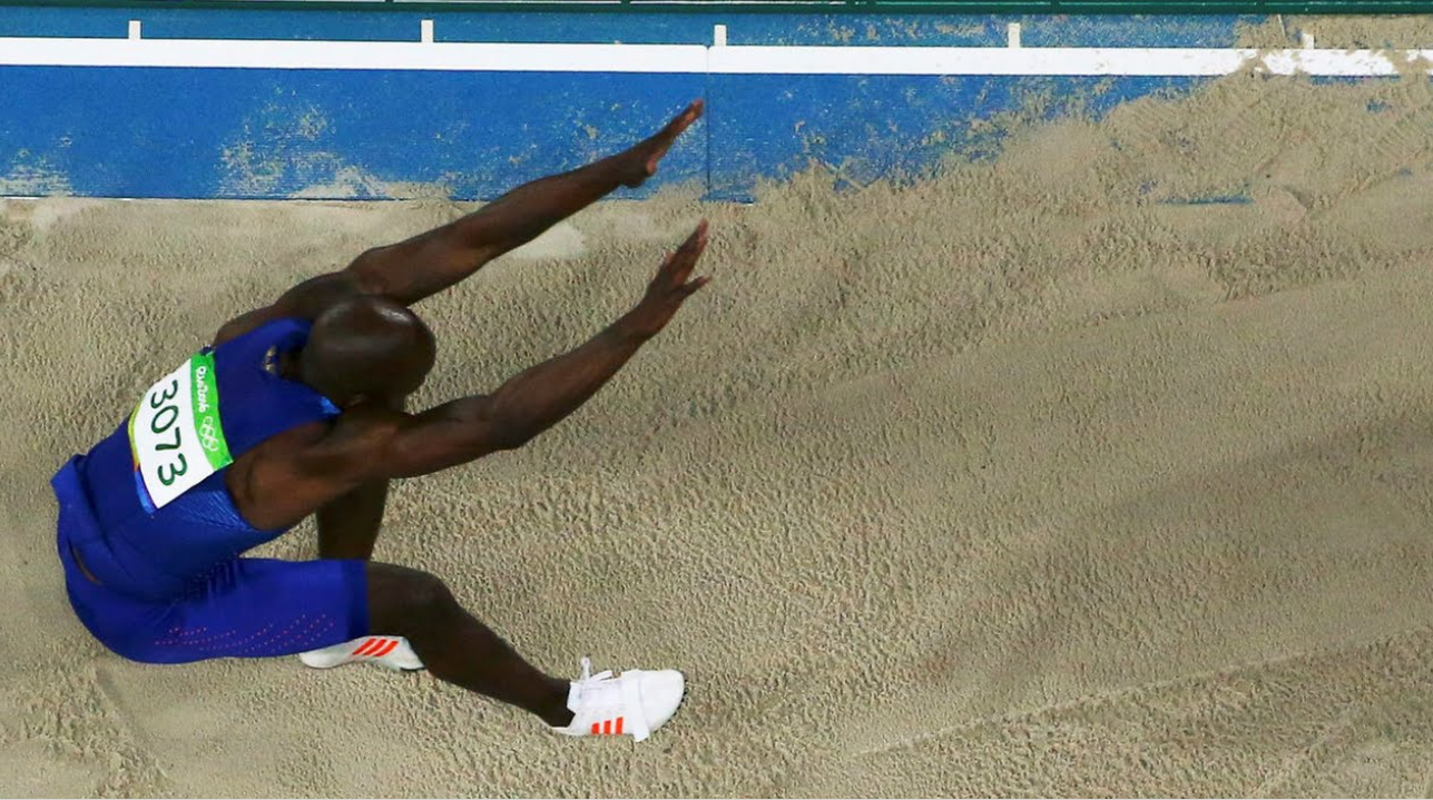 Olympics-London long jump champ Rutherford scrapes into final